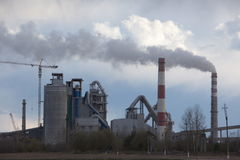 Cement plant smoke from the pipe manufacturing factory Stock Photo