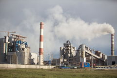 Cement plant smoke from the pipe manufacturing factory Stock Image
