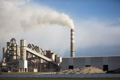 Cement plant smoke from the pipe manufacturing factory Stock Photos