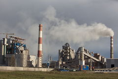 Cement plant smoke from the pipe manufacturing factory Royalty Free Stock Image