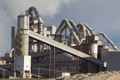 Cement plant smoke from the pipe manufacturing factory Royalty Free Stock Images