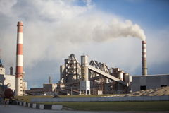 Cement plant smoke from the pipe manufacturing factory Royalty Free Stock Photography