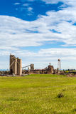 Cement plant during sunny day Stock Images