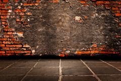 Cement plaster on red brick Structure of the walls to hold it down and cement  flooring. Stock Image