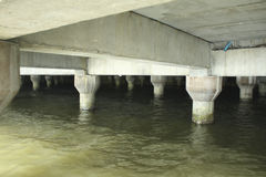 Cement pole of the  bridge, wave hit the pole of the bridge. Cement pole of the bridge, wave hit the pole of the under bridge Stock Images