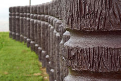 Cement pole in wood like in curve line. Cement pole in wood like place in curve line royalty free stock images