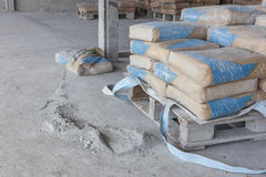 Cement is a powder ground from broken bags. Stock Photography