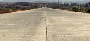 Cement road meeting to horizon Stock Photography