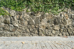 Cement road with stone rocks wall Royalty Free Stock Photography