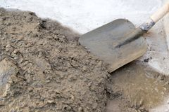 Cement solution with a shovel.  Royalty Free Stock Photography