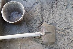 Cement solution with a shovel.  Stock Photo