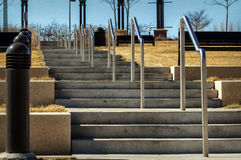 Cement Staircase. A set of steps leading out of the park Royalty Free Stock Image