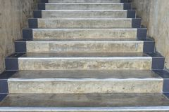 The Cement stairs step into higher background - construction detail royalty free stock photos
