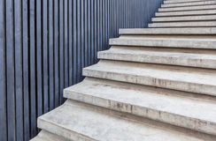 Cement stairway with blue wood wall in modern building. Royalty Free Stock Images