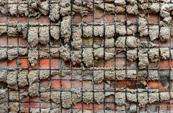 Cement and steel textured cobbled wall background Royalty Free Stock Images