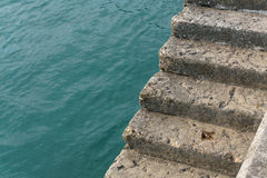 Cement steps on the edge of a quay Stock Photos