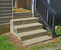Cement steps at front of house. Detail of utilitarian cement steps at front of house Royalty Free Stock Photos