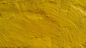 Cement surfage. Colored conkrete. Yellow. background.texture Royalty Free Stock Photo