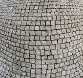 Cement tile curving outward into a bulge. Cement blocks of tile protruding outward forming a curved bulge pattern royalty free stock photography