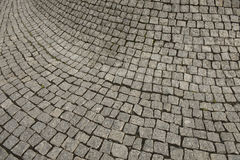 Cement tile curving outward into a bulge. Cement blocks of tile protruding outward forming a curved bulge pattern as it turns into a corner royalty free stock photography