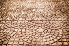 Cement tiles floor. Rough textured stone tiles,. Exterior walkway, perspective view Royalty Free Stock Photo
