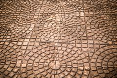 Cement tiles floor. Rough textured stone tiles, exterior walkway,. Perspective view Royalty Free Stock Photo