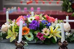 Cement tombstone with flowers in cemetery,religion royalty free stock photos