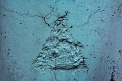Cement triangle on the wall. Streetart royalty free stock photography