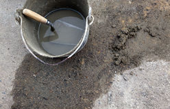 Cement trowel in bucket Royalty Free Stock Photo