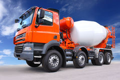 Cement truck. New red cement mixer truck