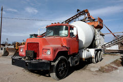Cement Truck. Close-up of old red and white cement mixing truck Stock Image
