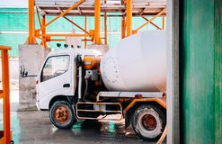 Cement truck of Cement batching plant factory. At loading area stock photo