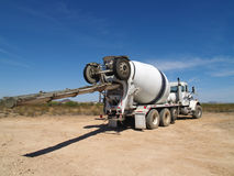 Cement Truck on Excavation Site - Horizontal. A cement truck is parked on an excavation site.  Horizontally framed shot Stock Image