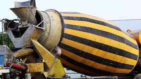 Cement truck operating in a construction site. Cement mixer truck operating in a construction site stock video footage