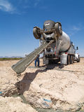 Cement Truck Pouring Cement into Hole - Vertical Royalty Free Stock Photo