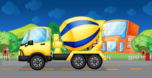 A cement truck running in the street Royalty Free Stock Photography