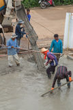 A cement truck and worker are pouring cement to new floor. NAKHON RATCHASIMA -JULY 6 : A cement truck and worker are pouring cement to new floor at construction Stock Photography