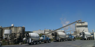 Cement trucks loading Stock Photography