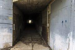 Cement tunnel with open door Stock Image