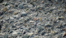 Cement wall. A close-up shot of a cement and stone retaining wall Royalty Free Stock Photo