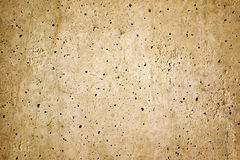 Cement Wall. Texture of uneven spotted cement wall royalty free stock image