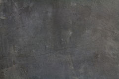 Cement Wall Background. A rough and raw grey random pattern cement wall with some little cracked on it Royalty Free Stock Images