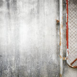 Cement wall background with rusty iron chain Stock Image