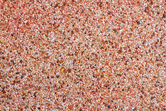 Cement wall covered by colorful stone Stock Photo