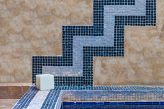 The cement wall decorates with blue tile Stock Image