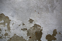 Cement wall with flaked plaster Royalty Free Stock Photography