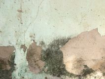 Cement wall gliding, peeling of painted wall old. royalty free stock images
