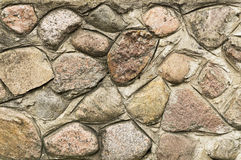 Cement wall with large stones Stock Images