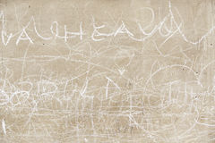 Cement wall with letters written Royalty Free Stock Photo