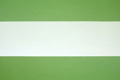 Cement wall painted green and cream color. Royalty Free Stock Images